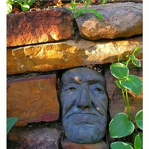 Garden Decor: A Face in the Fence from Boyle Sculptures