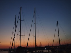 Sunset and sailboats in Siracusa Harbor  4