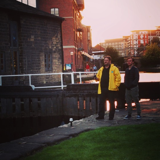 Douglas and Joseph watching canal boats lock through in Leeds Center