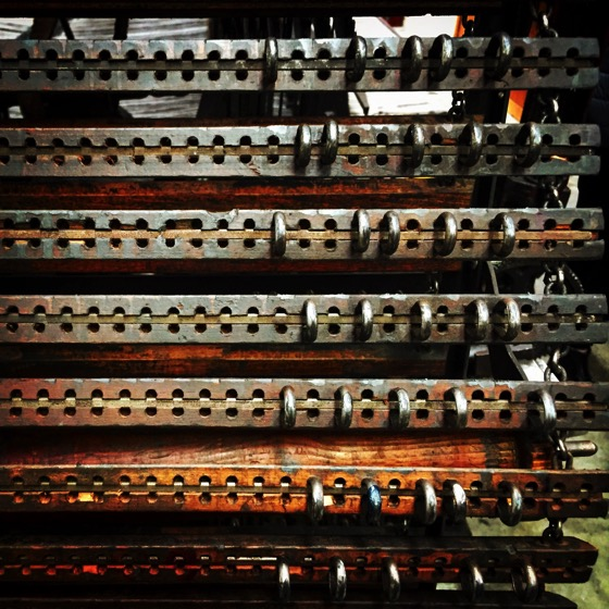Pattern control pegs (like a computer program) on Turn of the Century Loom