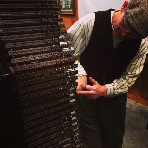 Master weaver explains pattern control pegs on turn of the century loom, Stansborough LTD Woolen Mill, Petone, Lower Hutt, New Zealand