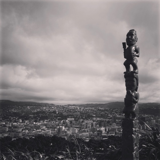 A Maori statue (Pou) on the ridge of Mount Victoria (Tangi-ke-teo), Wellington, New Zealand - Black and White