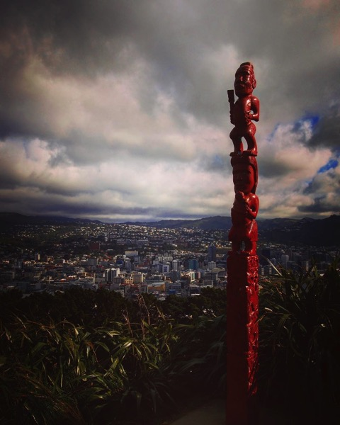A Maori statue (Pou) on the ridge of Mount Victoria (Tangi-ke-teo), Wellington, New Zealand