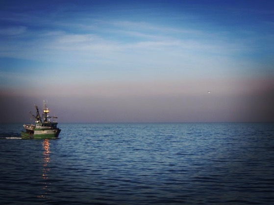 Fishing boat and smoke plume on way to Santa Cruz Island via Instagram