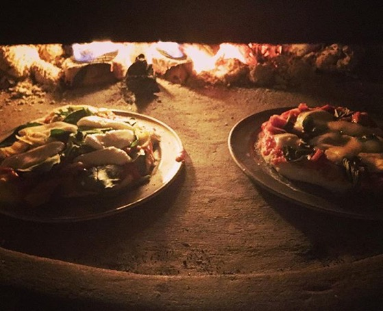 Pizza — my favorite food — In our friends new pizza oven  via Instagram