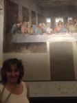 Rosanne in front of a painting that has been part of her life forever