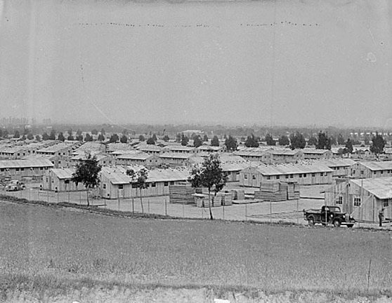 View of barracks being constructed on Pomona Fairgrounds, Apr. 8, 1942, Pomona Assembly Center, California. Courtesy of the National Archives and Records Administration, Ctrl. #: NWDNS-210-G-B88, NARA ARC #: 536837, WRA, Photographer Clem Albers More info »