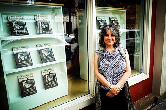"Rosanne and front window display of ""When Women Wrote Hollywood"" before reading and Signing event at Skylark Bookshop"