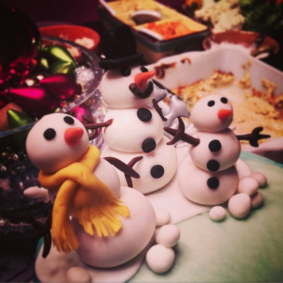 Snow Family atop the cake. A cool cake at a friend's party last night. [Photo]
