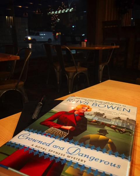 Some light reading over dinner – Crowned and Dangerous by Rhys Bowen
